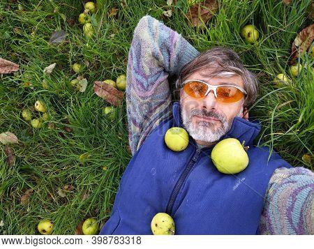 Smiling Mature Man, Apple Harvest Abundance Concept