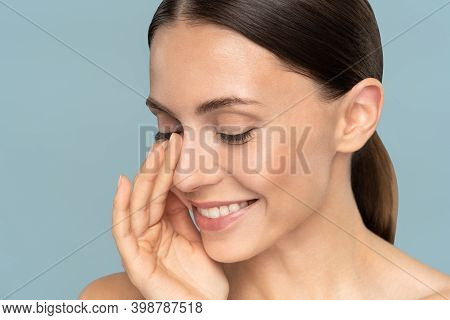Young Woman With Natural Makeup, Combed Hair, Touching Her Well-groomed Pure Skin On Face, Closed Ey