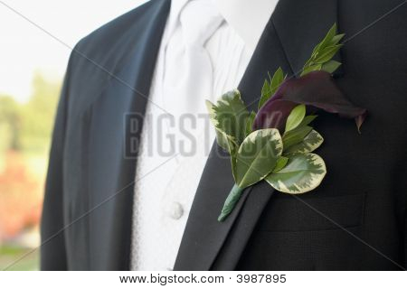 Purple calla lily wedding boutonniere on suit of groom poster
