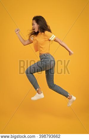 Run Hard To Arrive At Goal. Dynamic Woman Run Yellow Background. Sexy Girl Jump With Long Run. Energ