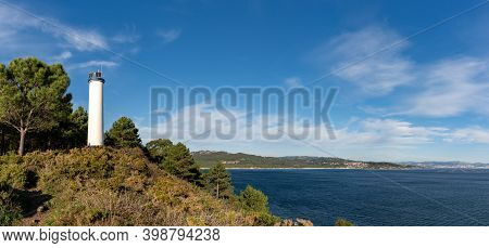 A Panorama View Of The Punta Sobrido Lighthouse At The Mouth Of The Vigo River In Galicia