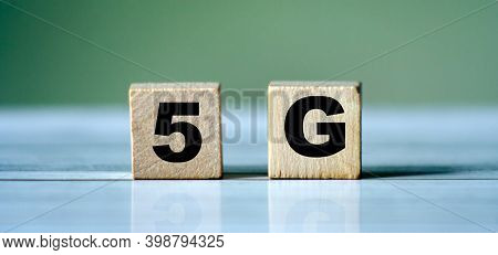 The Wooden Blocks With The Word 5g. High-speed Mobile Internet. New Generation Networks. Big Data Te