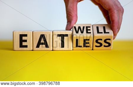 Eat Less Or Well. Male Hand Flips Wooden Cube And Changes The Words 'eat Less' To 'eat Well'. Beauti