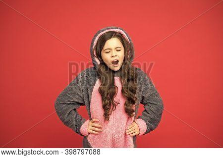 Sleepy And Yawny. Sleepy Baby Red Background. Sleepy Child Wear Pajamas Red Background. Sleepy Girl