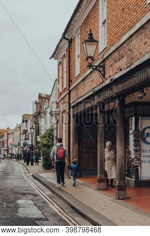 Rye, Uk - October 10, 2020: People Walk On High Street Past Adams Of Rye Printers And Stationery Sho