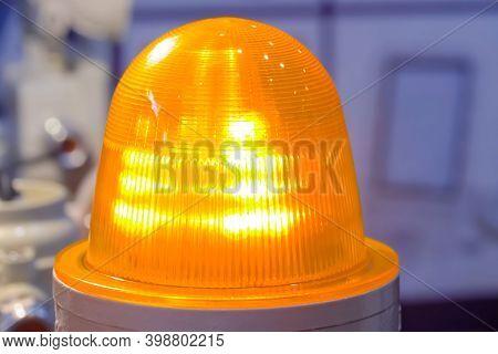 Close Up Of Orange Alarm Lamp Signal Warning Flashing Light For Industrial Machinery At Emergency, S