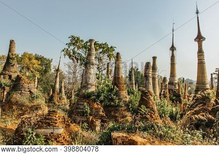 A Group Of Ancient Buddhist Pagodas In The Village Of Indein On Inle Lake, Myanmar. Burmese Cultural