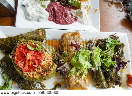 Turkish-style Stuffed Green Pepper (biber Dolması) And Other Vine Or Cabbage Leaves With Savory Stuf