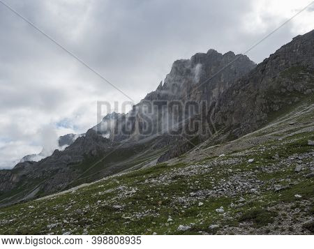 View On Limestone Moutain Peak Partialy Covered By Clouds At Stubai Hiking Trail, Stubai Hohenweg, A