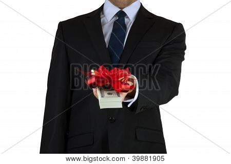 businessman holding cash with ribbon