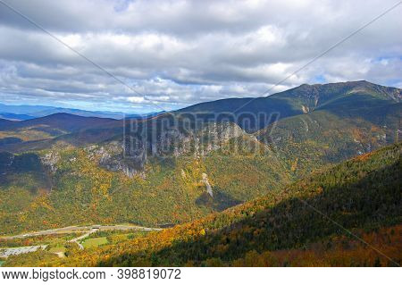 Franconia Notch With Fall Foliage And Highway I-93 Aerial View From Top Of The Cannon Mountain In Fr