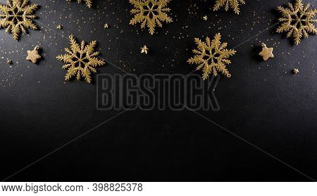 Christmas And New Year Background Concept. Top View Of Christmas Snowflake And Stars On Black Wooden