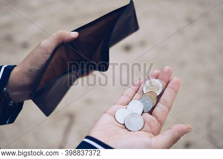 Woman Holds An Empty Purse And Coins In Hand Meaning Money Financial Problem Or Bankrupt Jobless, Br