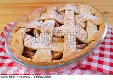 Delectable Fresh Baked Homemade Tasty And Healthy Apple Pie On Checker Kitchen Cloth