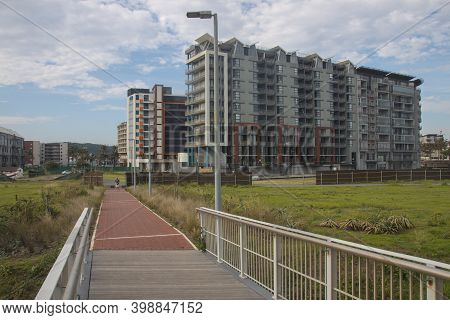 Many Modern Tall Residential Apartments With Grassy Area