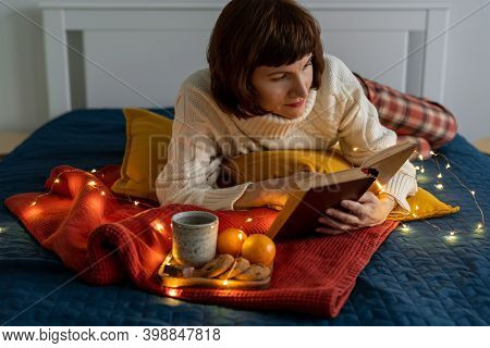 Beautiful Mature Woman Reading Book. Cozy Everning Relaxing And Reflection. Stay Home Concept. Chris