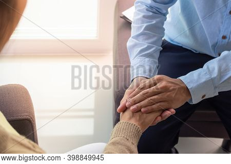 Psychiatrist Is Touching Hands To Comfort Women With Depression Or Female Patients Have Been Sexuall