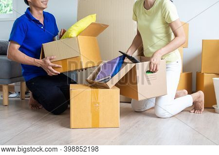 Couples Are Helping To Unpacking Boxes Moving Out Or Moving In House. Moving Home Concept