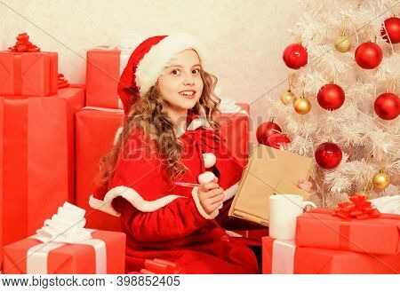 Kid Santa Hat Enjoy Christmas Eve. Child Writing Letter To Santa Claus. Dear Santa. Believe In Mirac