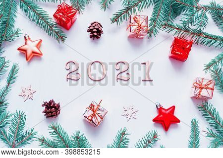 2021 New year background. New Year 2021 background with 2021 figures, Christmas toys, fir branches. Flat lay, top view of New Year 2021 composition, 2021 card, 2021 background, 2021 New year card