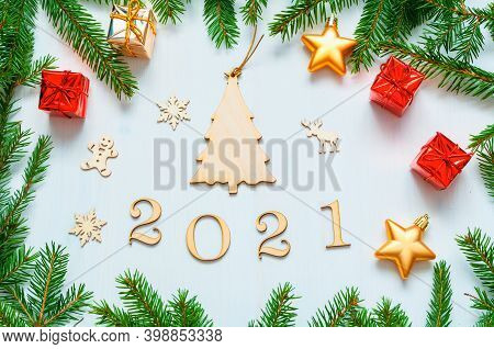 2021 New year background. New Year 2021 background with 2021 figures, Christmas toys, green fir branches-New Year 2021 composition Concept of New Year 2021 holiday with New Year objects