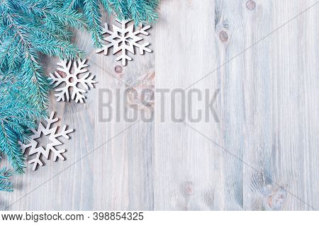 Christmas background. New Year and Christmas background. Christmas toys, blue fir tree branches on the wooden background. Christmas border, New Year and Christmas still life, free space for Christmas text