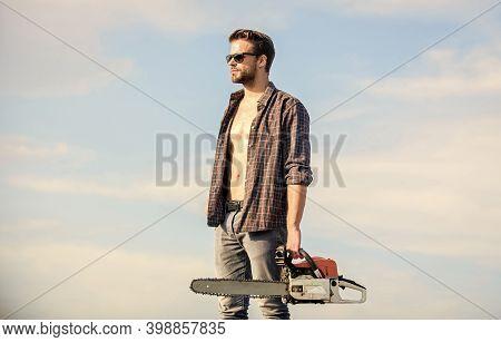 Gardener Lumberjack Equipment. Lumberjack With Chainsaw In His Hands. Dangerous Job. Feeling Confide