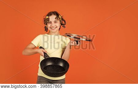 Portrait Of Cute Little Girl With Pan. Funny Little Housewife With Pan. Cute Funny Little Girl Weari