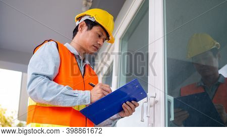 The Inspector Or Engineer Is Checking The Building Structure And Door Specifications. After Renovati