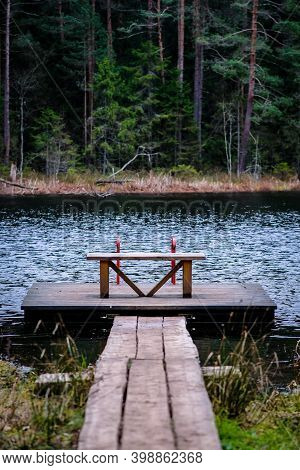 Footbridge On The Autumn Lake In Forest. Autumn Mood. Vertical Photo