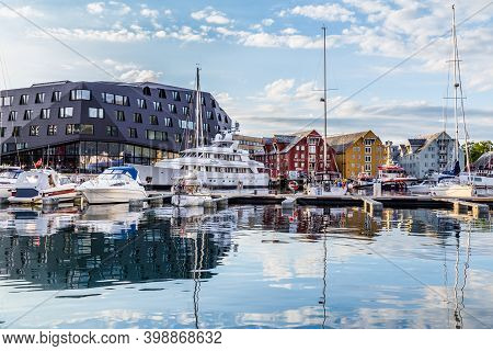 Tromso, Finland - July 26, 2016: Harbor With Old Warehosues In The Center Of Tromso In Northerm Norw
