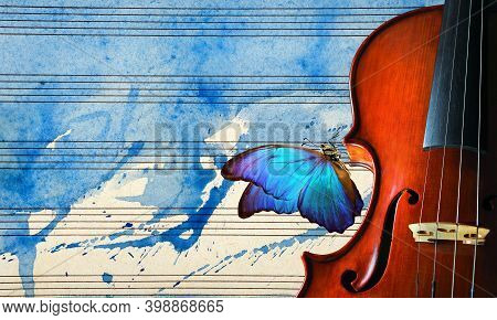 Violin On The Background Of The Sheet Music. Violin On Blue Watercolor Background Closeup. Beautiful
