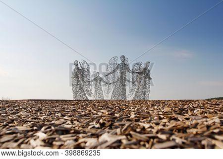 Kamenka, Lipetsk Oblast, Russia - August 07, 2020: Metal Sculpture Of Angels Holding Hands As Art Ob