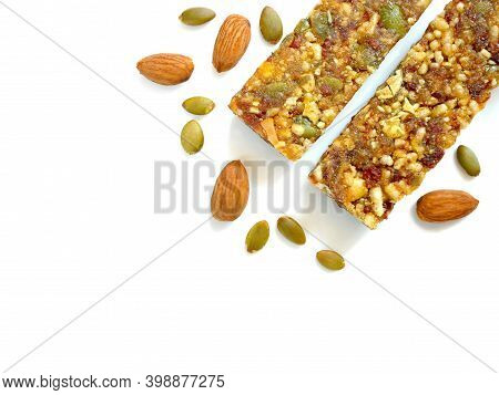 Whole Wheat Cereal Bars Or Flapjacks With Pumpkin Seeds, Almonds And Dried Fruit Isolated On White B