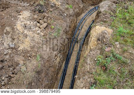 Laying High Voltage Cables To The Ground. The Environment Does Not Damage Electric Poles. Excavation