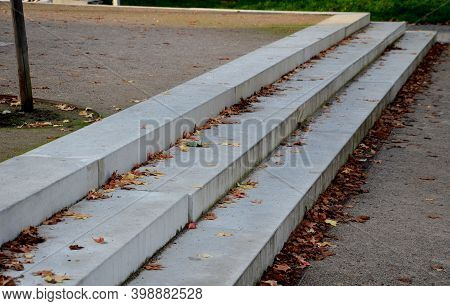Concrete Stairs To The Park Serving At The Same Time As A Sitting Bench. Gray Cement Clean Smooth Br