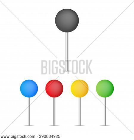 Colored Pins An Tacks On The White Background