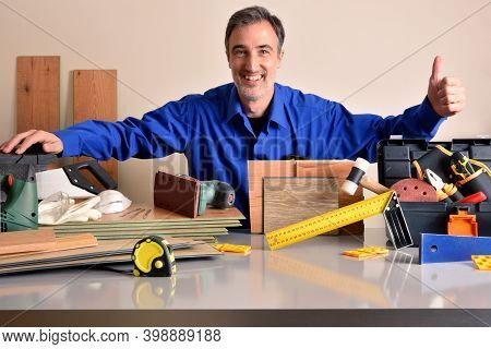 Supplier Of Material For The Assembly And Maintenance Of Parquet Showing Tools And Materials Smiling