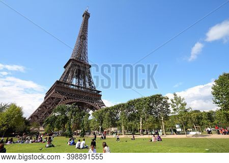 Paris, France - July 21, 2011: People Rest In Front Of Eiffel Tower In Paris, France. Eiffel Tower W
