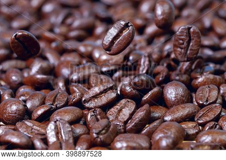 Coffee Background. Levitation Of Coffee Beans. Texture Of Freshly Roasted Coffee. Several Coffee Bea