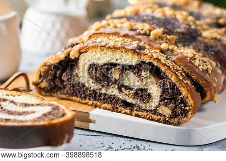 Christmas Poppy Seed Cake, Sliced Poppy Seed Cake Covered With Icing And Decorated With Raisins And