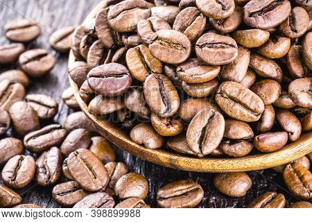 Rustic Wooden Spoon With Beautiful Selected Coffee Beans, Arabica Coffee For Export, Ready To Be Gro