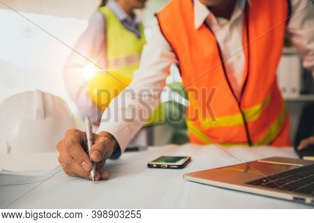 Engineer Or Architect Planning With Technology Concept, Construction Worker Draw And Designer On Blu