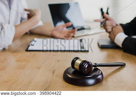 Hammer Of Law On Table With Lawyer Talk And Explain Legal Document To Businessman, Advisor Recommend