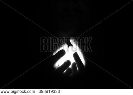 Hands In The Dark Holding The Light Between Her Fingers. Conspiring In The Dark.