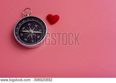 Compass And Heart On A Pink Background, The Direction Of Love.