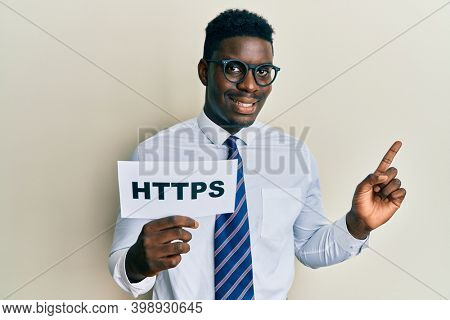 Handsome black man holding https privacy url smiling happy pointing with hand and finger to the side