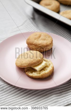 Homemade Flaky Buttermilk Biscuit On A Pink Plate On Cloth, Low Angle View. Close-up.