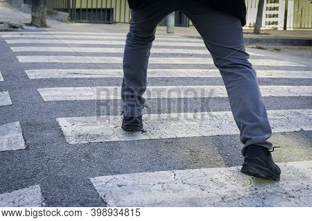 Obsessive Compulsive Disorder, Man Trying Not To Step On The Black Lines Of A Pedestrian Crossing