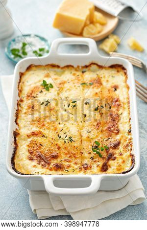 Cheesy Scalloped Potatoes With Thyme And Parmesan